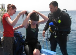 Andrea assists Sue with her costume after a dive